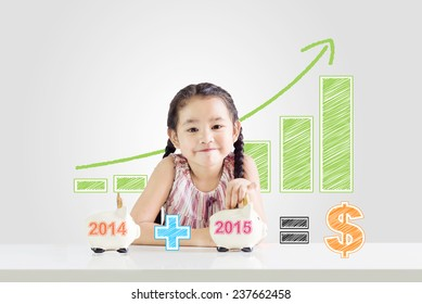 little girl putting money on a piggy bank with a new year 2015.saving concept from 2014 until 2015 drawing - Shutterstock ID 237662458