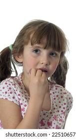 A little girl putting on lip gloss