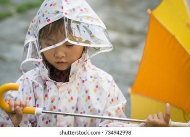 Little girl in a raincoat