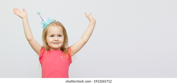 Little girl raising her hands up. Ready for your text or logo. Isolated on white background