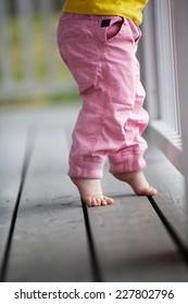 Little girl reaching up