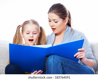 Little girl read book with mother.