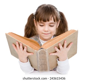 28e34c686f81 little girl reading big book. isolated on white background