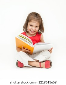 little girl reading a book isolated on white background