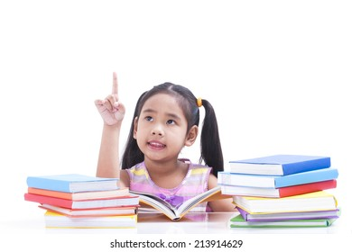 Little girl is reading book and pointing up.