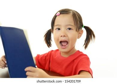 Little girl reading her book