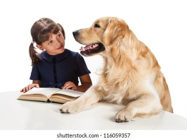 little girl reading with her golden retriever