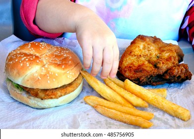 Little girl ready to eat fast food. Children healthcare concept. Real people