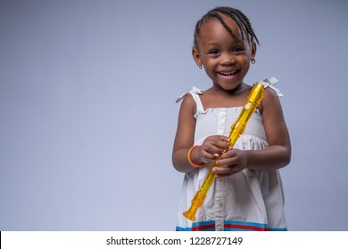 Little girl with recorder