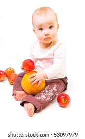 little girl with the red apples. she is sitting on the floor