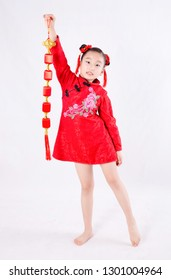 Little girl in red cheongsam holding a lantern