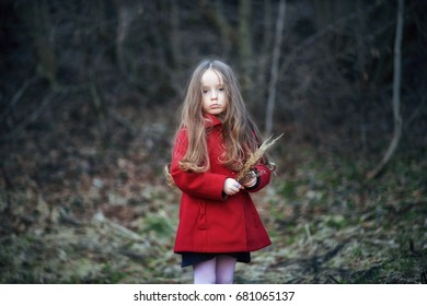 little girl in red coat, cute, beautiful, pretty, boots with the flower stands in a field at sunset