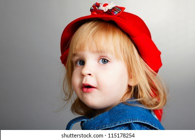 little girl with red hat