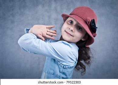 little girl in red hat looking and smiling