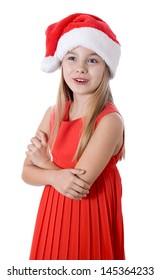 little girl in red santa hat on white background. portrait