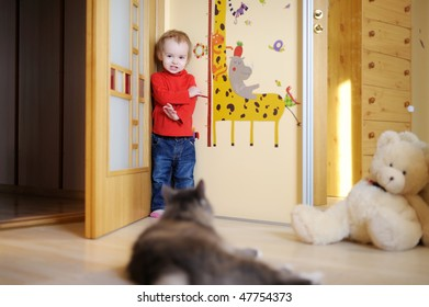 Little girl in red shirt and her cat