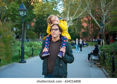 Little Girl Resting on Father's Shoulders