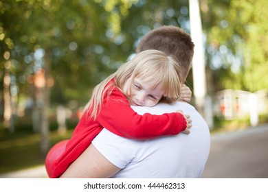 Little Girl resting on her father's shoulder