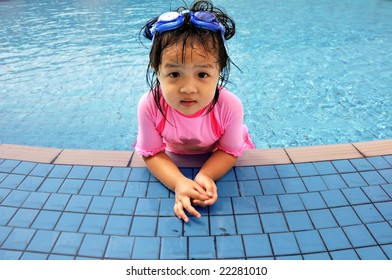 little girl resting at the swimming pool