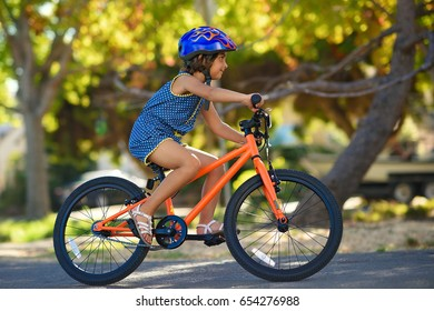 Little Girl Riding Her Bicycle