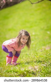 Little girl, running in the park
