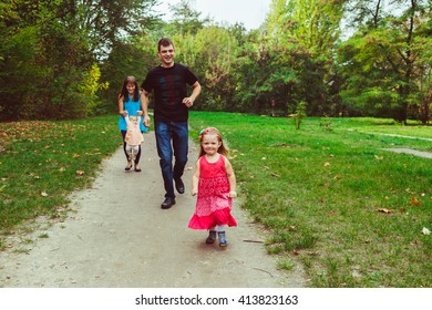 Little girl is running in the pink dress