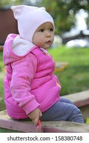 Little girl in the sand yard
