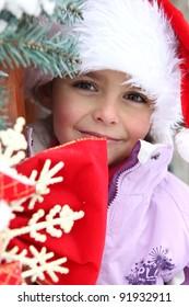 Little girl in a Santa hat