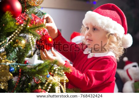 0ae63dda06d0f Little Girl Santa Hat Decorates Christmas Stock Photo (Edit Now ...