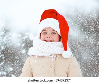 Little girl with Santa hat in park outdoor, close up