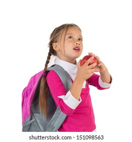 Little girl in school uniform looking up wistfully and holding an apple, isolated