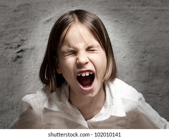 little girl screaming with eyes closed