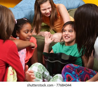 Little girl sharing a joke with her friends