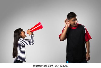 Little girl shouting her brother