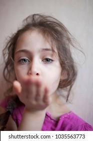 Little girl is showing an air kiss
