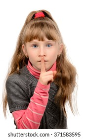 Little girl showing sign silence.