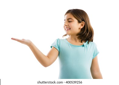 Little girl showing something over her hand, isolated in white background