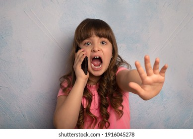 Little girl showing stop sign and shouting