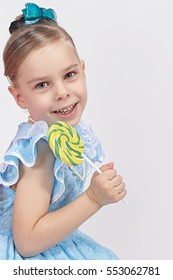 Little girl shows a beautiful large lollipop