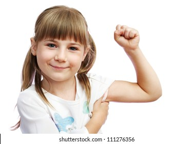 The little girl shows the biceps