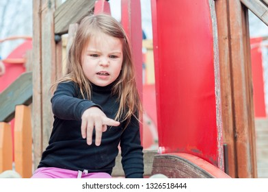 Little girl shows disgust at something. Annoying concept.