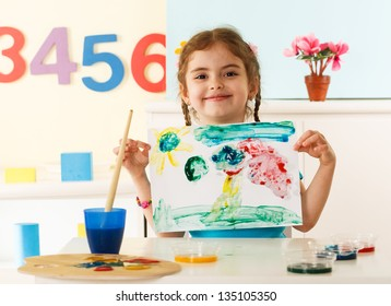 Little girl shows her painting