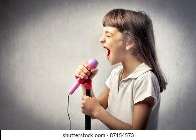 Little girl singing into the microphone