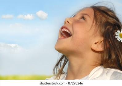 Little girl singing on meadow