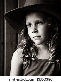 Little girl sitting in barn with light on her face 03cc731bad1c