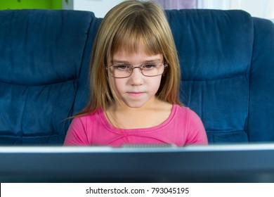 Little girl sitting at the computer.