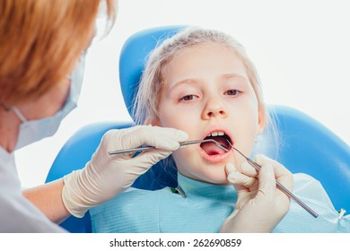 Little girl sitting in the dentists office.