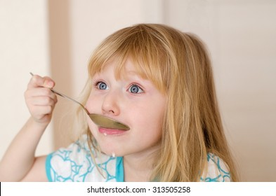 little girl sitting and eating breakfast
