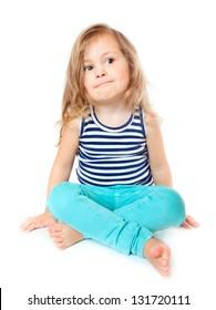 Little girl sitting, isolated over white