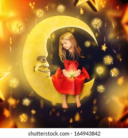 A little girl is sitting on an art drawing of a bright yellow moon with falling stars in the background. The child is making a wish for an imagination or bedtime concept.